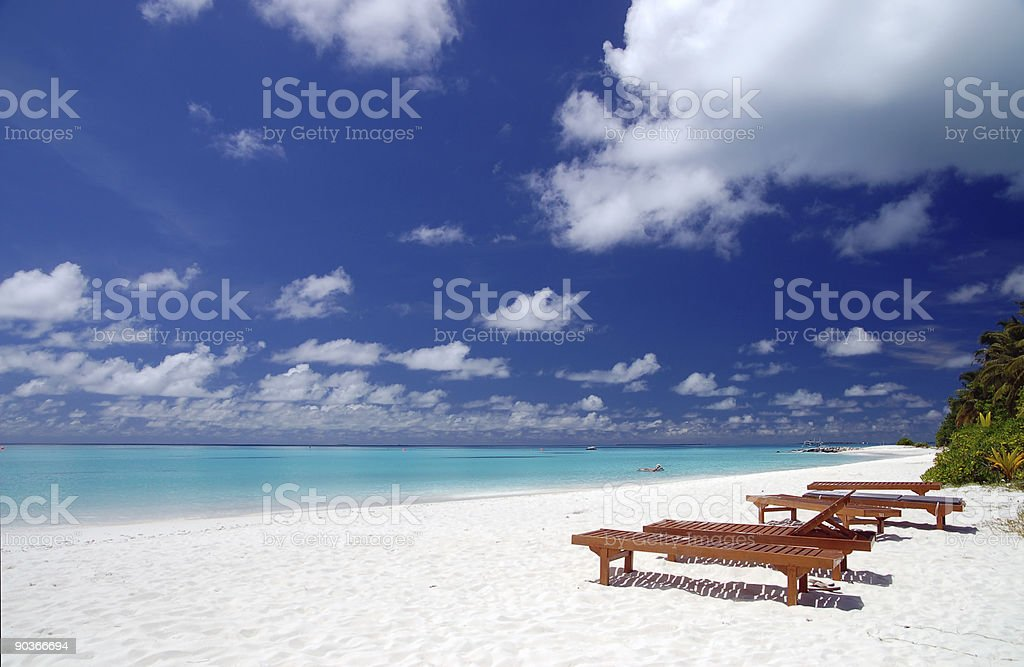 canvas chairs on tropical beach stock photo