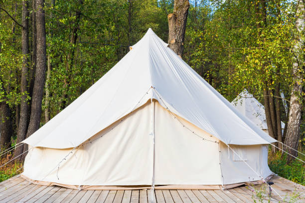 Canvas glamping tent at forest stock photo