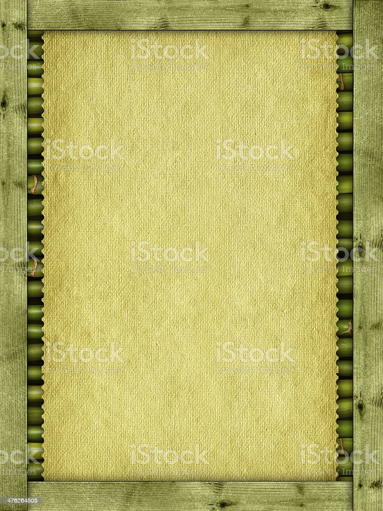 Canvas or handmade paper sheet, planks and bamboo sticks royalty-free stock photo