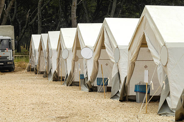 Canvas pole tents in a row ready for action stock photo