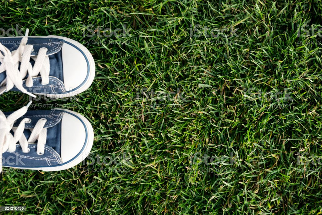 Canvas shoe on fresh grass