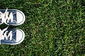 Canvas shoe on fresh grass