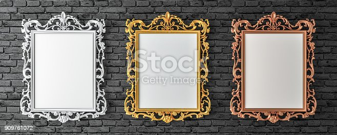 istock Canvas with vintage gold, silver, broze frames on brick wall 3d render 909761072
