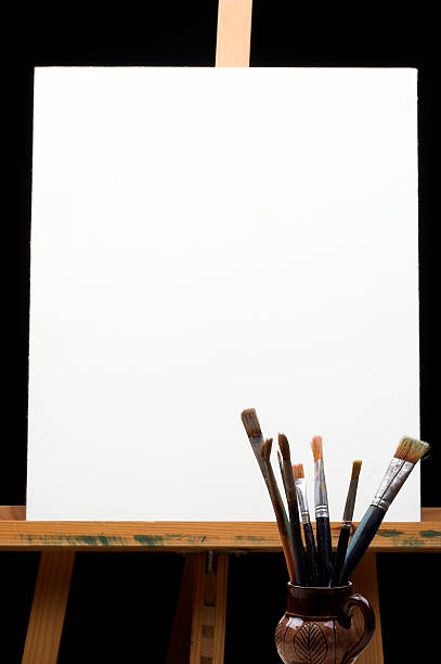 canvas,brushes and easel stock photo