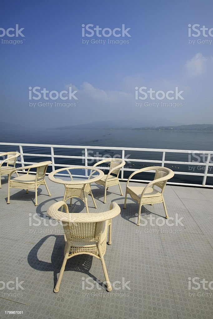 cany chair on ship's deck royalty-free stock photo