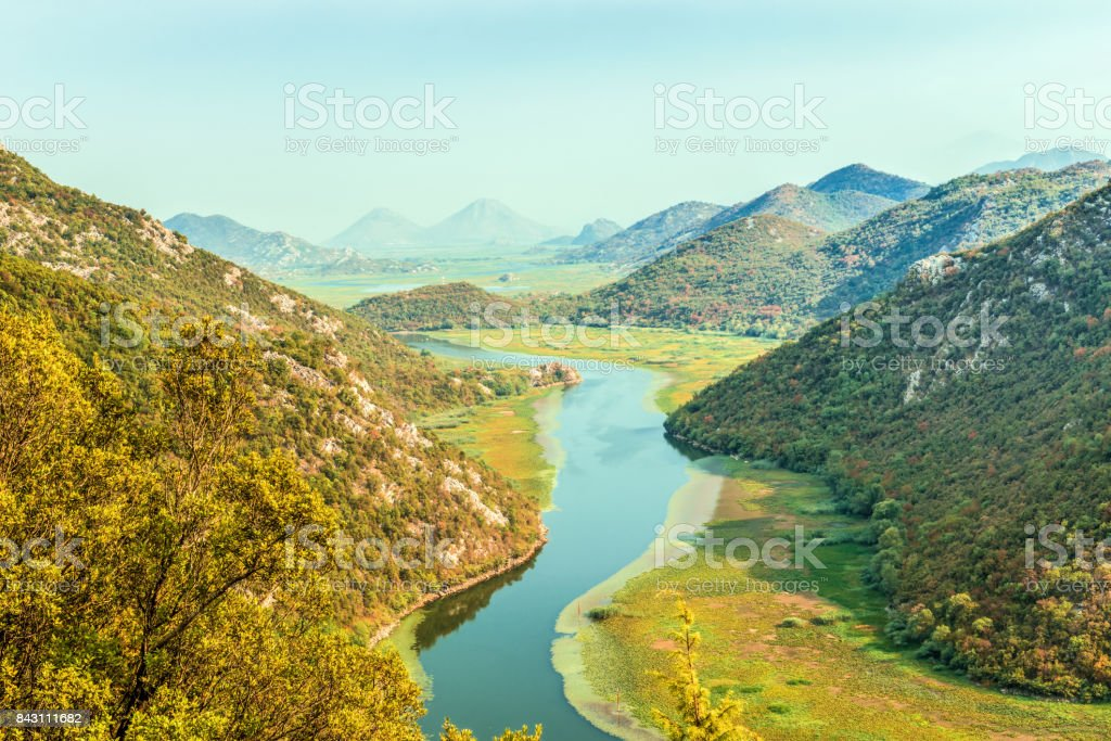 Canyon  Crnojevica river near the Skadar lake coast. One of the most famous views of Montenegro. River makes a turn between the mountains and flows backward. stock photo