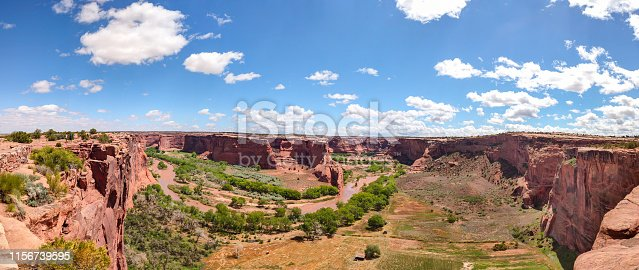 Canyon de Chelly, Arizona, Navajo nation, United States. Panoramic view of the red rocks and the river, blue sky background