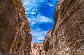 Canyon in the sandy rocks of Petra overlooking the blue sky. The ancient Nabataean city in Jordan.