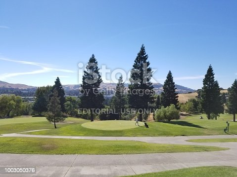 San Ramon, California, United States - July 17, 2018:  Golfers tee off in the early morning at Canyon Lakes Golf Course in San Ramon, California, July 17, 2018