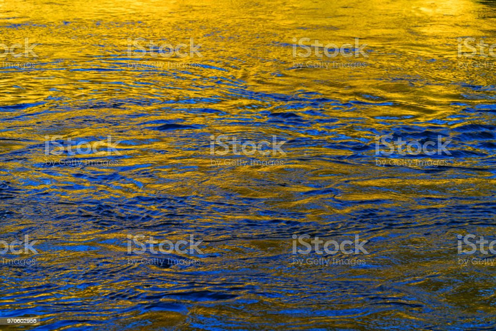 Canyon Reflections in River Water Blue and Gold stock photo