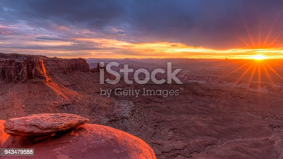 The setting sun lights up Junction Butte and the Island in the Sky in Canyonlands National Park, Utah.