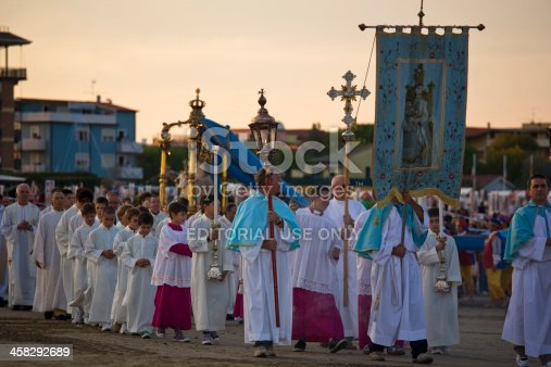 Caorle, Italy - 12 september 2010: The procession is about to end, she came from the sea by fishing boats, at this time is on the beach.We see the crucifix, the banner of the portrait of the Virgin Mary, the priests, the children to follow you can see the statue of the Madonna and the rest of the procession.