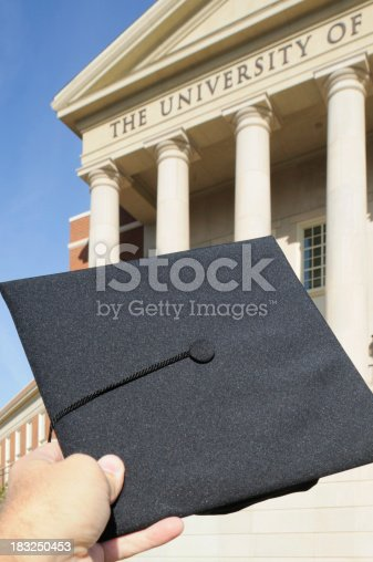 istock Cap and tassel in front of the university sign 183250453