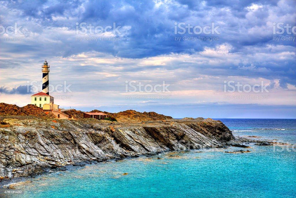 Cap de Favaritx sunset lighthouse cape in Mahon stock photo