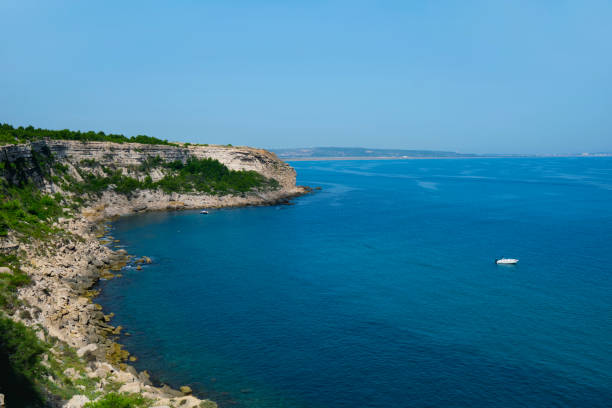 Cap des Freres cape in Leucate, France a view of the coast of the Cap des Freres cape in Leucate, France, bordering the Mediterranean sea, and La Franqui beach in the background headland stock pictures, royalty-free photos & images