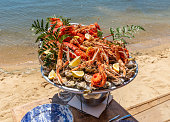 Seafood tray on the terrace of an oyster restaurant at seaside