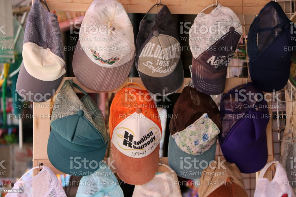 b10998f4 Cap hanging on the shelf display for sale in the local market. - Stock  image .