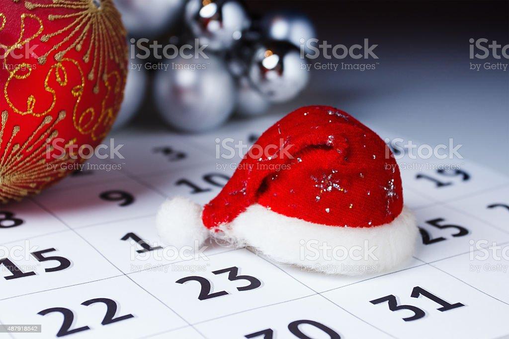 Cap of Santa Claus on the calendar stock photo