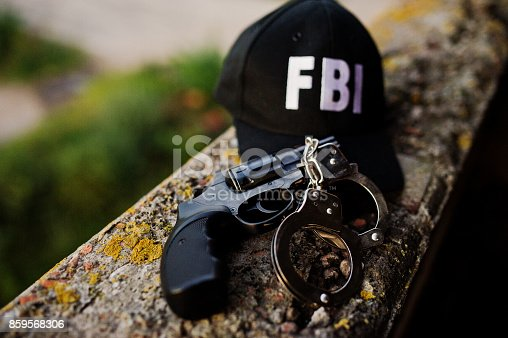istock FBI cap with revolver and handcuff. 859568306