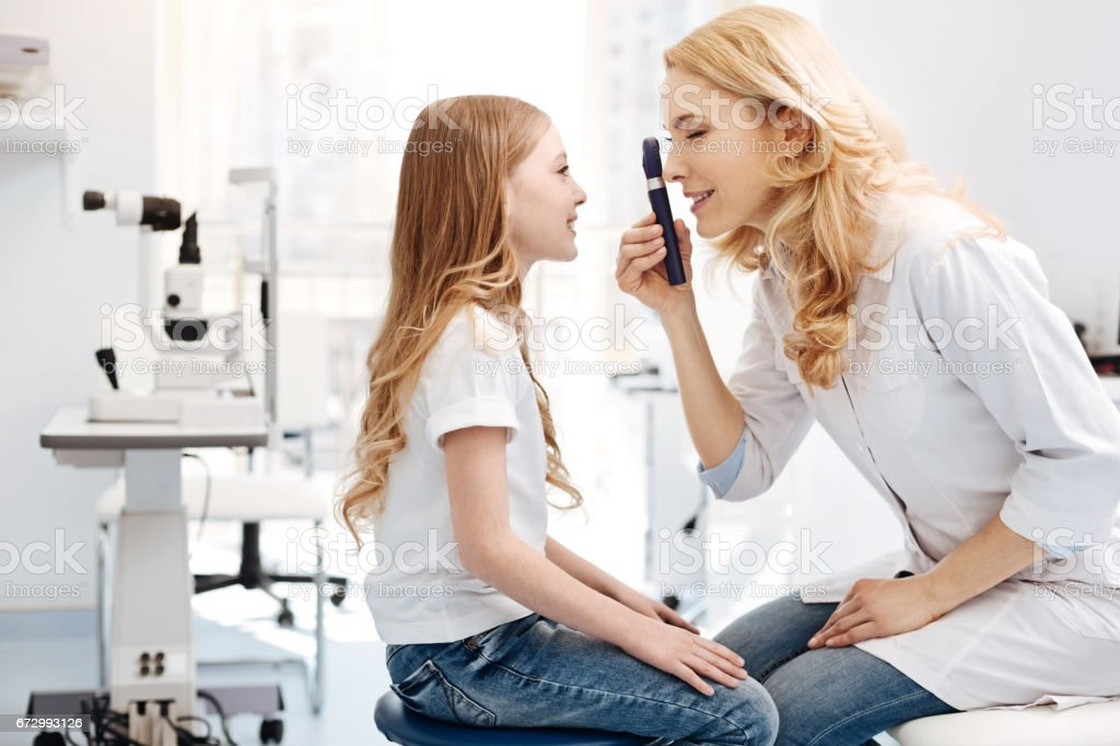 Capable private doctor running a routine checkup stock photo