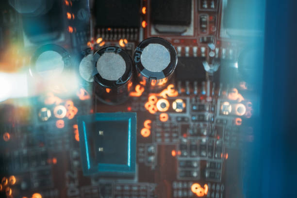 capacitor microchip print circuit board innovation - capacitor stock photos and pictures