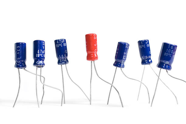 capacitors in a row - capacitor stock photos and pictures