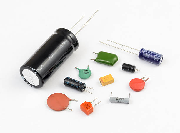 capacitors. various kinds - capacitor stock photos and pictures
