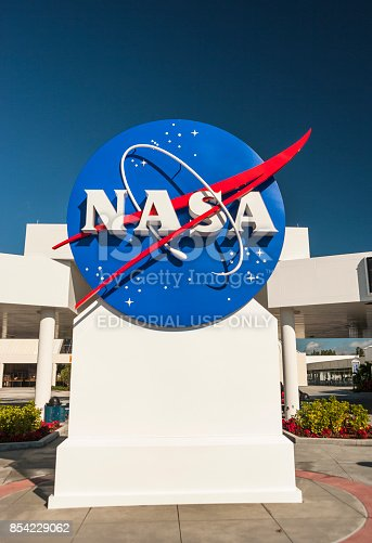 Cape Canaveral: NASA logo at the entrance of the Kennedy Space Center in Cape Canaveral Florida USA.  The National Aeronautics and Space Administration or NASA is an independent agency of the executive branch of the United States federal government responsible for the civilian space program, as well as aeronautics and aerospace research.