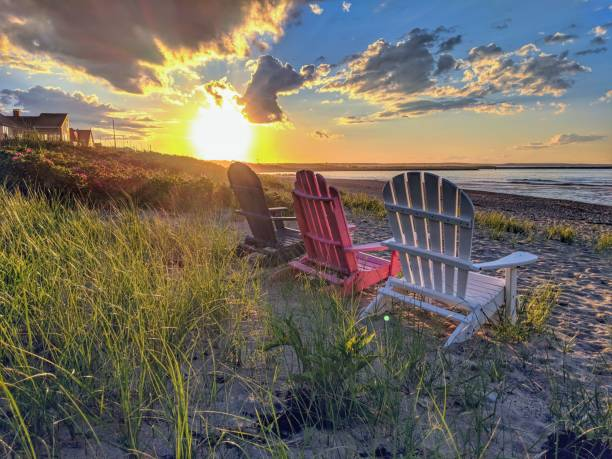 Cape Cod Beach at Sunset Aidirondack Chair's overlooking the sunset cape cod stock pictures, royalty-free photos & images