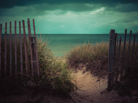 Cape cod beach entrance on a stormy day