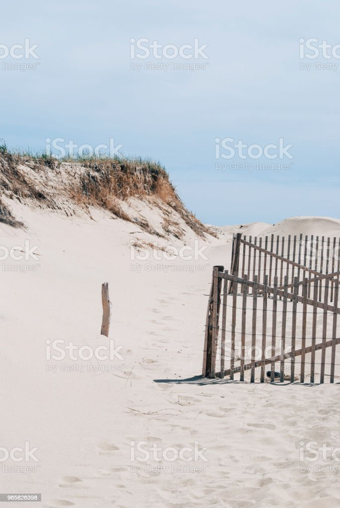 Cape Cod beach with wooden fence - Royalty-free Beach Stock Photo