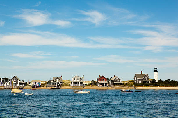 "cape cod: houses by the sea ""houses and lighthouse by the sea near hyannis port, massachusetts, usa. click for more:aocean/seaai"" cape cod stock pictures, royalty-free photos & images"