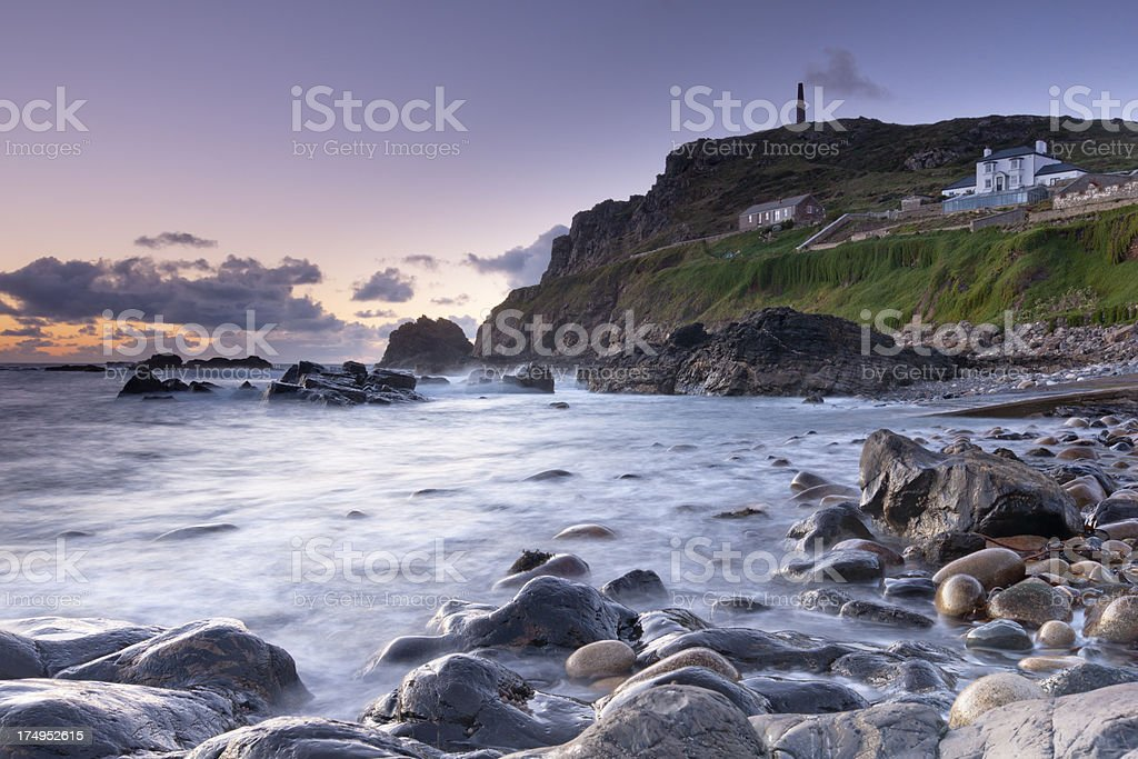 Cape Cornwall at sunset showing the beach and headland royalty-free stock photo