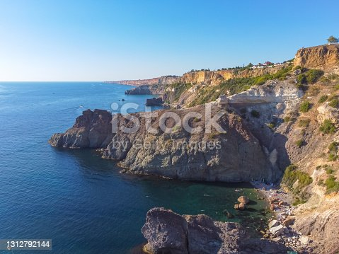 istock Cape Fiolent. Beautiful views of the Black Sea coast at Cape Fiolent in summer in clear weather. Aerial view to beautiful sea coast with turquoise water and rocks 1312792144
