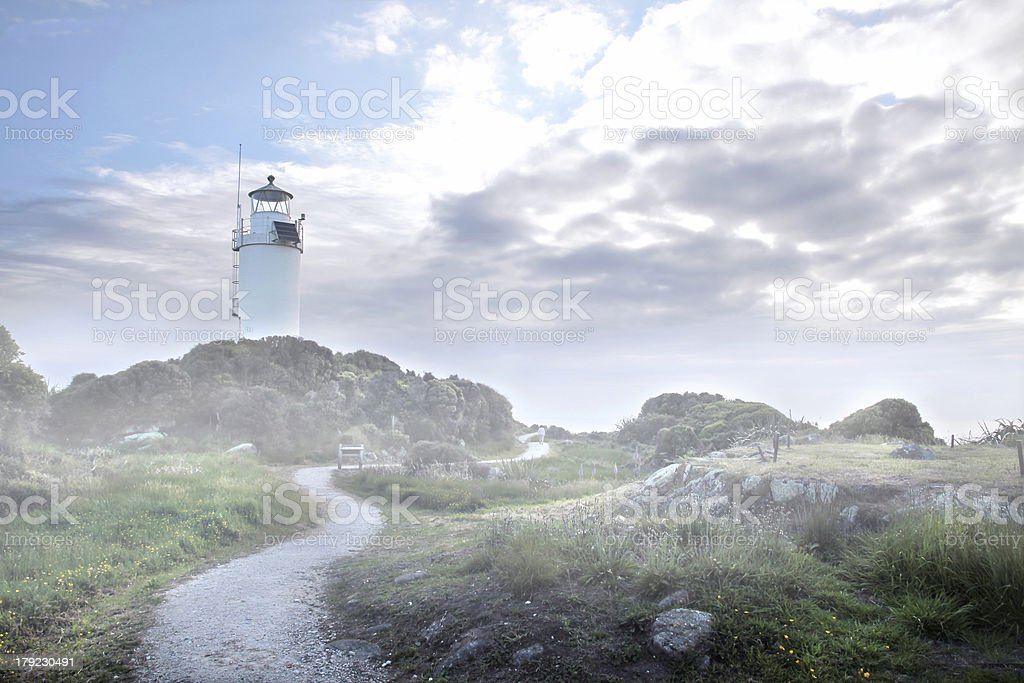 Cape Foulwind Lighthouse in the fog stock photo