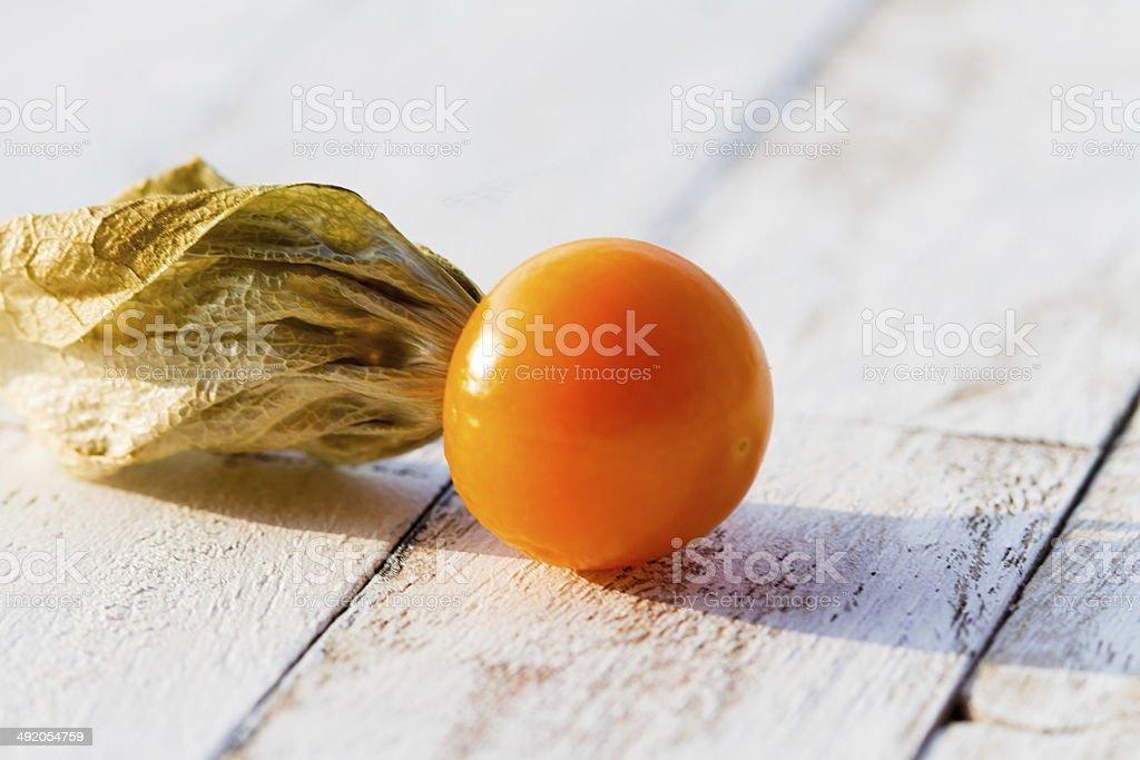Cape Gooseberry fruit on old white wooden floor stock photo