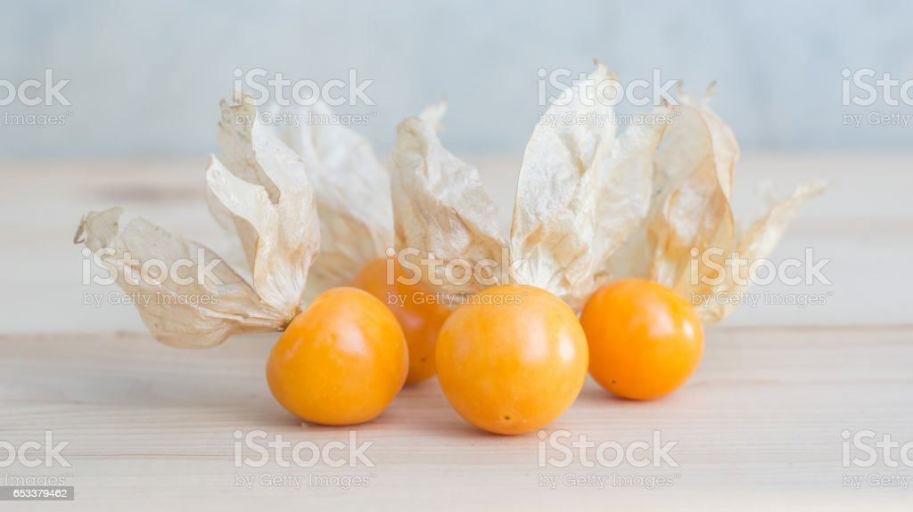 Cape gooseberry on wooden background, selective focus. stock photo