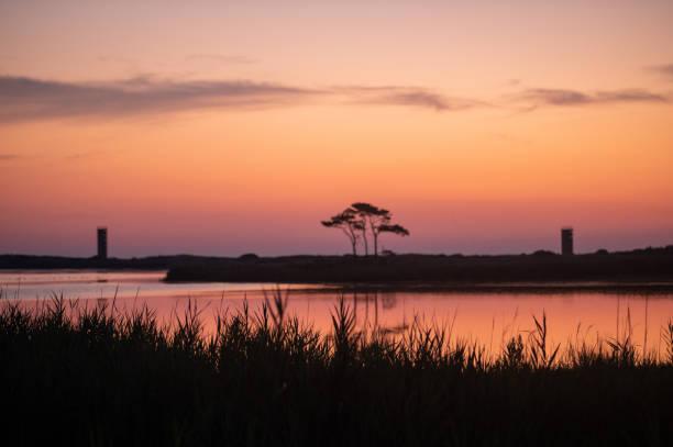 Cape Henlopen sunrise at Gordons Pond stock photo