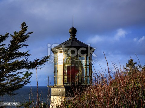 Sunlight reflects off the Cape Meares Lighthouse beacon