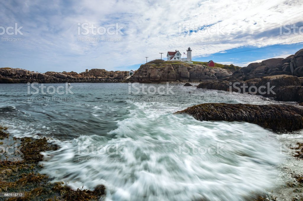 Cape Neddick Lighthouse (Nubble Lighthouse) at Old York Village, Maine, USA Стоковые фото Стоковая фотография