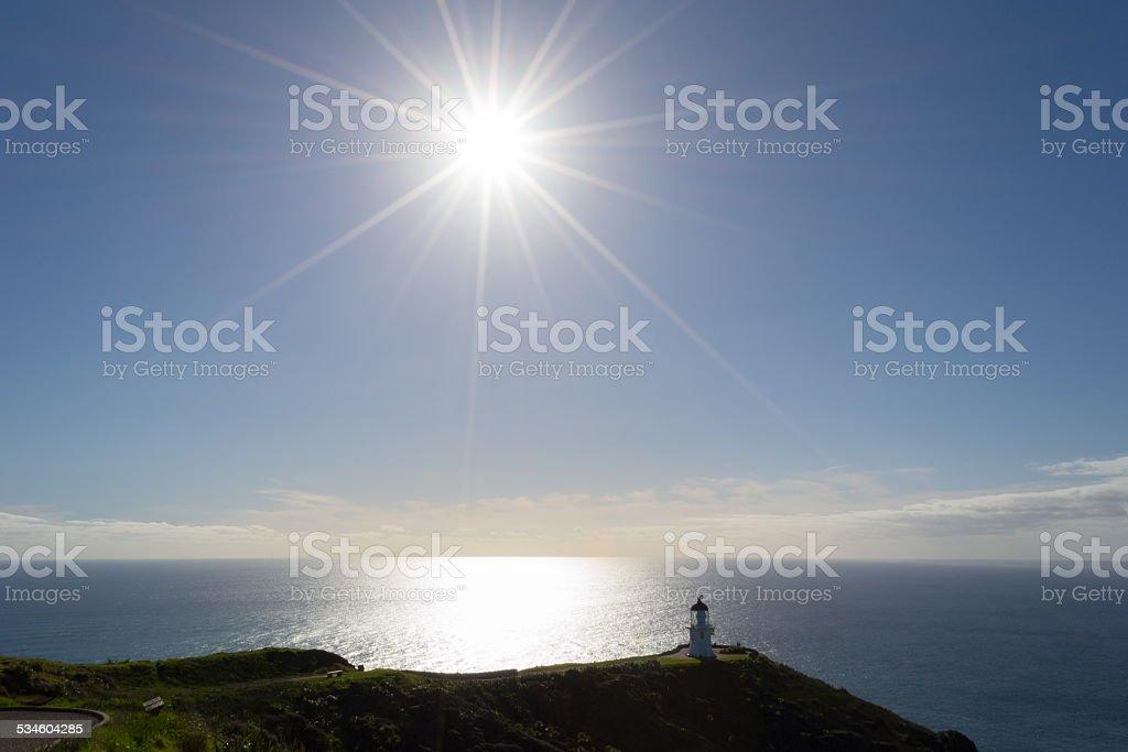 Cape Reinga lighthouse in backlight stock photo