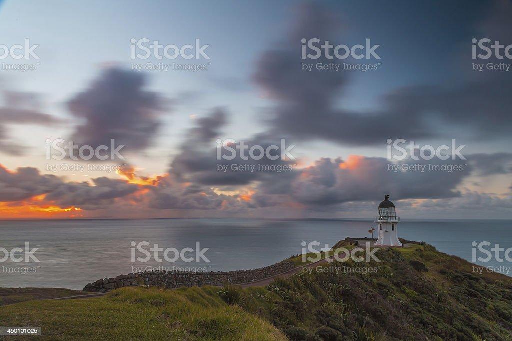Cape Reinga lighthouse sunset stock photo
