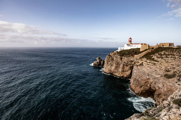 cape san vicente lighthouse algarve portugal - headland stock pictures, royalty-free photos & images