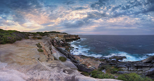 Cape Solander Panorama Australia Scenic views north at Cape Solander.  Sydney Australia.  You would not want to have been standing on the cliff ledges when it gave way and crumbled onto the lower rock shelf and ocean headland stock pictures, royalty-free photos & images