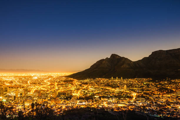cape town illuminated night scene south africa - table mountain national park stock pictures, royalty-free photos & images