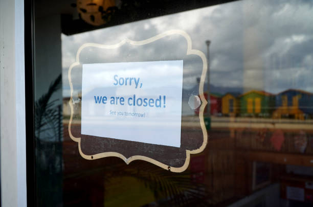 Cape Town, South Africa - 16 April 2020 :Closed shop sign in Cape town, South Africa during the lock down. stock photo