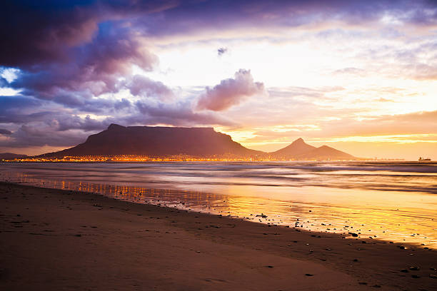 cape town table mountain sunset beach south africa - table mountain south africa stock pictures, royalty-free photos & images