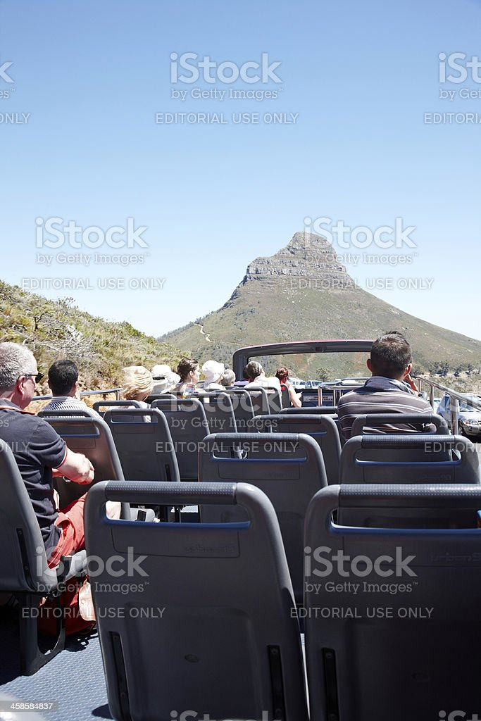 Cape Town tourist bus approaching Lion's Head mountain stock photo