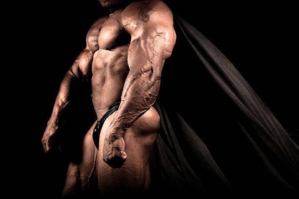caped figura - hombres grandes musculosos fotografías e imágenes de stock