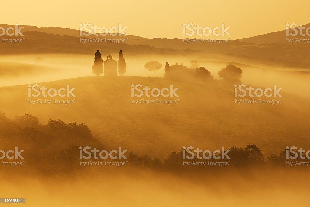 Capella di Vitaleta, Morning Fog, Sunrise Light, Tuscany, Italy royalty-free stock photo